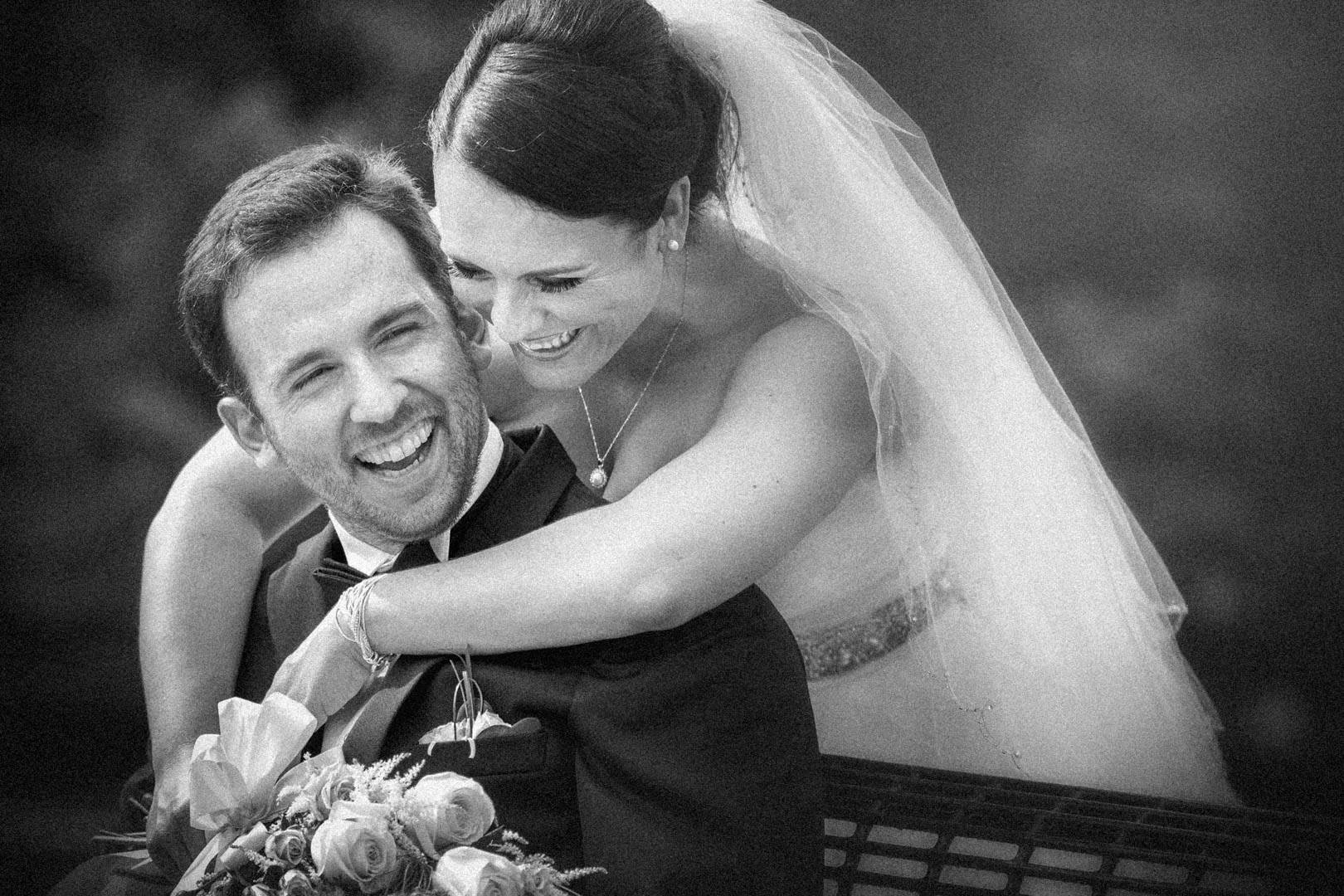 Bride and groom smiling together at their wedding