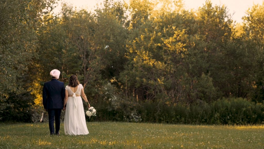 Bohemian wedding couple in a field